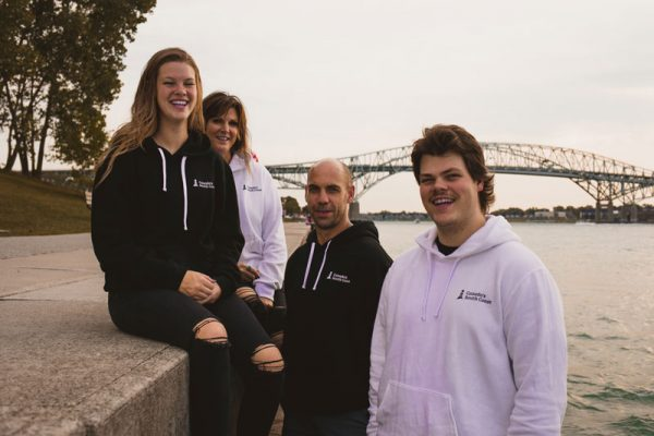 Canada's South Coast Clothing Co. Inc. Group Shot in front of Bridge